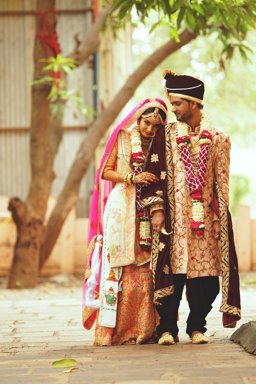 man and woman wearing traditional wedding costumes