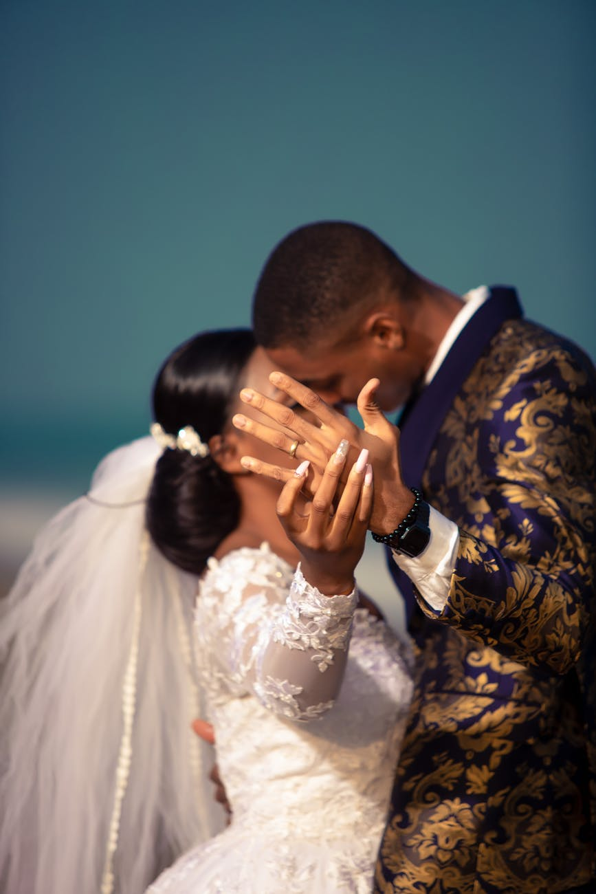 wedding black couple kissing and showing ring on ring finger
